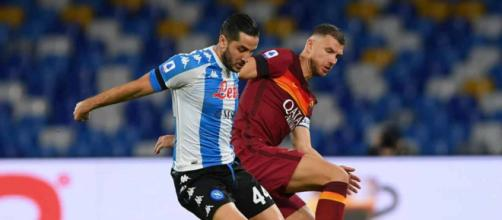 Manolas e Dzeko, durante il match d'andata Napoli-Roma.