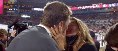 Brady receives a kiss from his wife Gisele after Super Bowl LV win (Image source: NFL/YouTube)