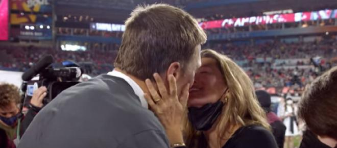 Tom Brady deflects retirement talk with his wife Gisele by giving her a big hug