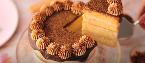 Tiramisu consists of ladyfingers layered with mascarpone mousse frosting, coffee glaze, and cocoa powder dust (Image source: EmmTASTY/YouTube)