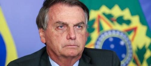 Bolsonaro pede para criança retirar máscara (Agência Brasil)