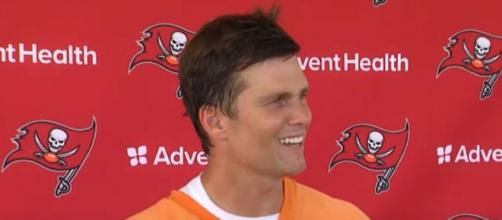 Brady enjoys his time with son Jack (Image source: WFLA News Channel 8/YouTube)
