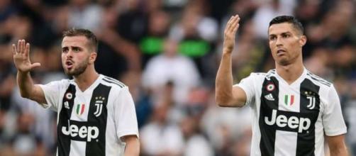 Miralem Pjanic e Cristiano Ronaldo.