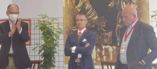 Enrico Letta e Marco Rizzo in un confronto.