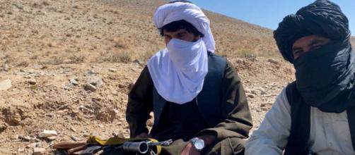 Stern-looking Taliban fighters (Image source: DW/YouTube)