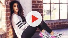 Selena Gómez en un grupo de estrellas haciendo foco primario en salud mental