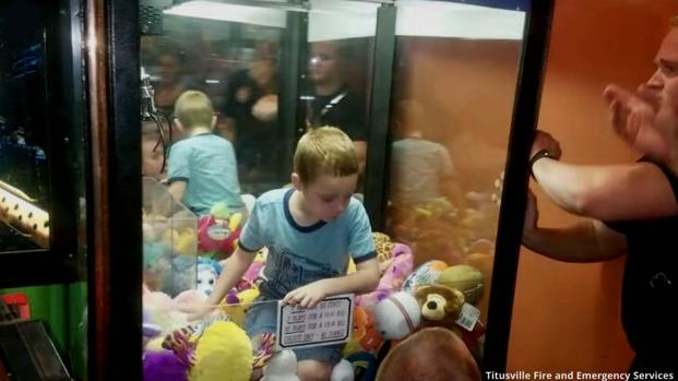Florida boy climbs into claw machine to get his toy but becomes trapped