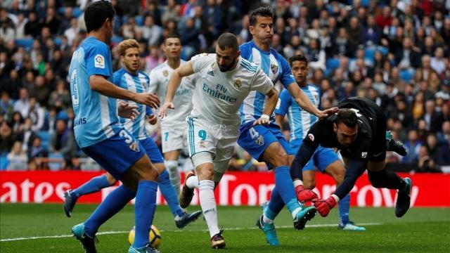 El Real Madrid celebra su victoria ante el Málaga