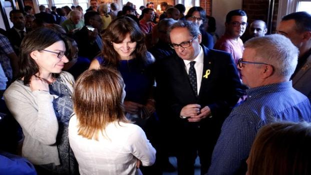 Torra abandona un acto en el que Morenés niega la existencia de presos políticos