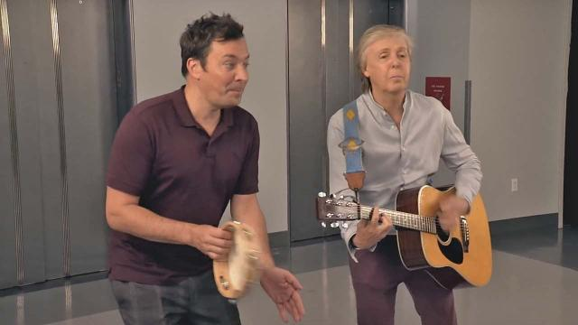 Paul McCartney and Jimmy Fallon surprise visitors in New York lift