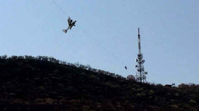Couple rescued in South Africa after their plane got caught up in a zip line