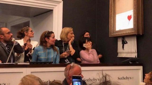 Banksy painting self-destructs after sold for £1m by Sotheby's
