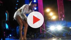 Ivete Sangalo usa rodo para puxar água em meio ao seu show