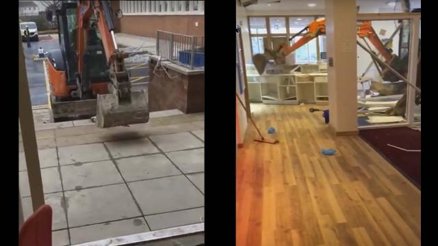 Worker drives digger into new hotel over pay dispute