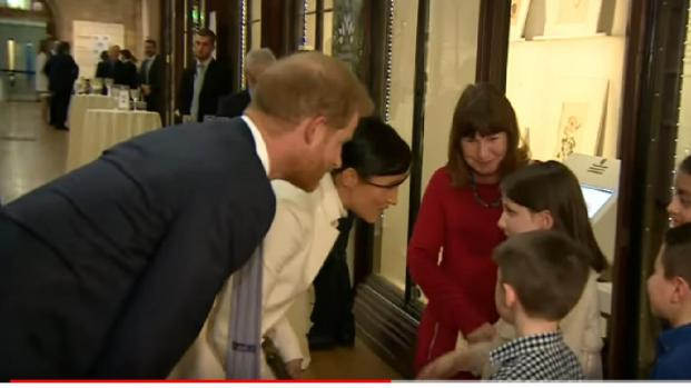 Meghan Markle and Prince Harry attend a program at the Natural History Museum
