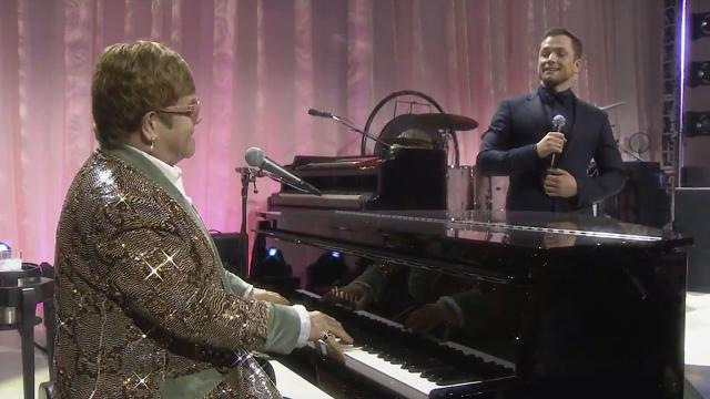 Elton John and Taron Egerton duet at his Oscars party