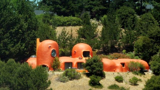 Owner of The Flintstone House sued by city over highly visible eyesore