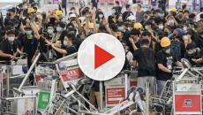 Hong Kong airport protest: Flights resume after second night of chaos