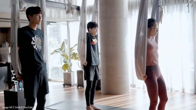K-pop stars Johnny Suh and Mark Lee of NCT 127 try out aerial yoga