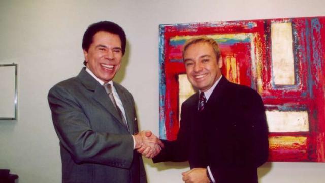 Ausente no velório, Silvio Santos envia homenagem para Gugu