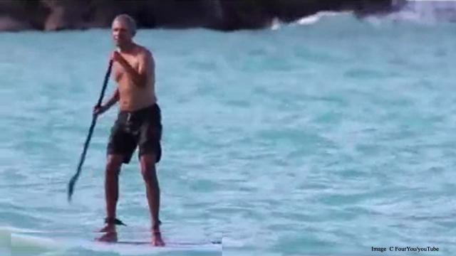 As Donald Trump orders strike on Iran, Barack Obama goes paddleboarding in Hawaii
